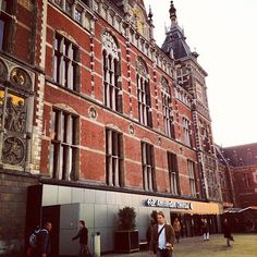 """Amsterdam central station, designed by Pierre Cuypers, on a beautiful morning. The building shows a strong similarity with the Rijksmuseum, also designed by Cuijpers. Both worth a visit, with Holland Pass you get """"prefered partner entrance""""at Rijkmuseum  #holland #amsterdam #rijksmuseum #hollandpass"""