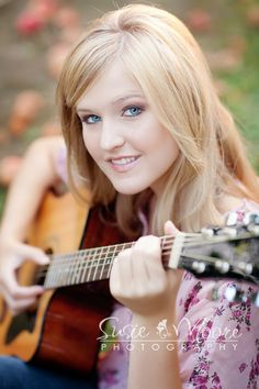 Lovely photo of a very pretty girl with her acoustic guitar.