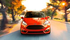 The 2015 Fiesta ST shown in Molten Orange Metallic Tri-Coat. Visit http://www.fordgreenvalley.com/