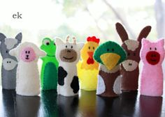 Old MacDonald has been the song of choice here lately so I thought I'd make some finger puppets to use as we sing. And somewhere to keep them. My barn and finger puppets were inspired by a pa…