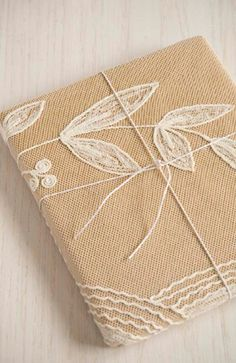 lace wrapping paper. pretty and clever way to upgrade brown paper.