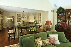 Love the green sofa and the green island! Pulls the rooms together!