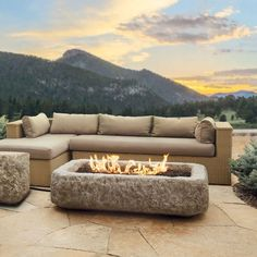 Enhance your patio experience with this chiseled limestone gas fire table. Modern and natural, this fire table is constructed with fiber-concrete and steel, and puts out up to 50,000 BTUs of heat. It comes complete with lava rock filler and a weatherproof cover.
