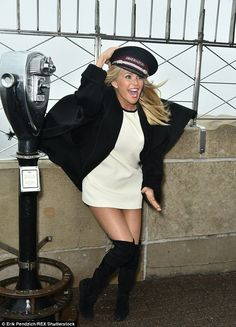 Gone with the wind! Christie Brinkley clutched her hat as she paid a visit to the Empire State Building in New York City for Smile Train on Tuesday
