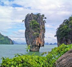 Ko Tapu or Nail Island is located in Phuket, Thailand. It's NOT in Dublin, Ireland and it certainly doesn't have a mansion on top with a ladder going down. Just thought everyone should know the truth about the *photoshopped* picture that's been floating around Pinterest lately.