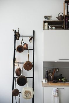 Looking for a fresh idea for how to store your pots and pans when you've run out of space in the cupboards? Repurpose a ladder as a pot rack!As far as small space storage solutions go, this is a nice twist on the more common wall or ceiling mounted pot rackor pegboard. It reminds me ofthis copper pipe utensil rack, but on a larger scale.What do you think? Would you ever try it?