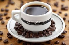 coffee cup with coffee beans. - Close-up shot of coffee cup and saucer with coffee beans.