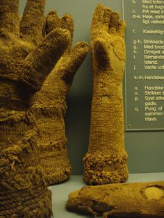 Knitted wool gloves, 16th/17th c excavated in Copenhagen. Note the purl pattern and the thrums in imitation of fur. Danish National Museum.