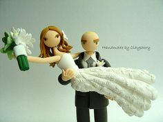 A redhead and bald guy cake topper - I love it!  Customized wedding cake topper by Clayphory, $130.00