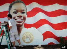 Eric Lindbergh of T.A.L.E.N.T. Murals works on the image of gymnast Gabby Douglas on the side of the Gator's Sports Bar & Grill in Virginia Beach, Va. on Thursday, Aug. 9, 2012.