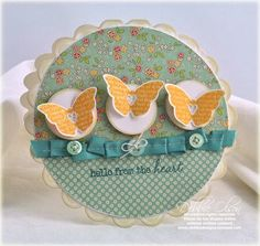Love the trio and ribbon/buttons. I love how all the patterned papers go so well together!