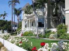 The Cheshire Cat Inn located in Santa Barbara. comprises of two stately Queen Anne Victorian homes with six guest rooms in each, an elegant coach house with two suites and three cottages, all surrounded by exquisite flower filled gardens and patios. The inn is situated just one block from Santa Barbara's main shopping street, which is full of attractive courtyards and alleys. #bedandbreakfast #travel