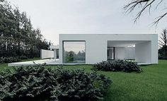 Tamizo Architects Group designed this absolutely stunning home in Pabianice, Poland. Modern and minimal!