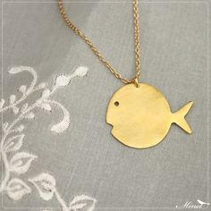bubbly fish necklace / gold fish necklace / cute fish necklace / whimsical fish / round fish necklace. $29.00, via Etsy.