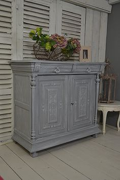 Looking for a stylish and practical storage solution? We adore this Vintage French Buffet Cupboard with it's intricate wooden carvings. Painted in Little Greene Mid Lead with Gauze Dark in a dry brush effect over the top. https://www.thetreasuretrove.co.uk/cabinets-and-storage/vintage-french-2-door-painted-buffet-cupboard #littlegreene #frenchfurniture #frenchstyle #shabbychic