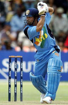 2003, Sachin Tendulkar hits a shot during a World Cup match between India and Zimbabwe at Harare.#IndiaDefends