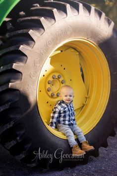 Packett – Armstrong Family | Ashley Goverman - little boy - farm photo shoot - tractor - tractor photo - toddler pose