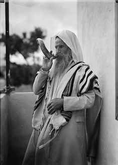 Yemenite Jew sounding the Shofar in a photograph from the 1930s.