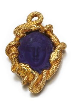 An antique amethyst brooch/pendant, late century and later. Set with an amethyst carved in relief with the face of Medusa, within a later mount naturalistically modelled as snakes, later brooch fitting with French import assay mark. Engagement Jewelry, Vintage Engagement Rings, Snake Jewelry, Fine Jewelry, Jewellery, Victorian Jewelry, Antique Jewelry, Silver Necklaces, Silver Earrings