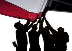 Sailors take down the American flag after a burial at sea ceremony aboard the aircraft carrier USS Enterprise (CVN 65).