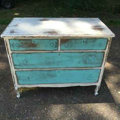 Antique dresser painted with Dixie Belle fluff and the gulf