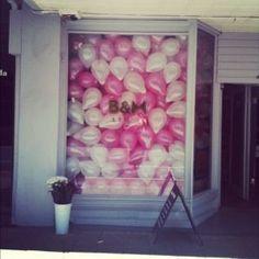 window full of balloons