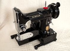 SINGER Featherweight 222 / 222K Free-Arm Sewing Machines  The Pinnacle of all Featherweights, from design to desirability.  Manufactured from 1954 - 1961. Perhaps the next machine?  Retail, it is a heart stopping $1195.00