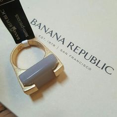 Banana Republic Ring Semi-Precious Stone Size 8 Modern an on-trend ring brand new with tags from Banana Republic. Gold ring holding a facted semi-precious stone. There is a natural mark and tiny chip in the stone shown in 4th photo. Ring was purchased this way. Stone is 1.5 cm x 2 cm. Ring is raised about 1 cm from finger when worn. Retail price $45. Banana Republic Jewelry Rings