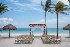 Let the beautiful color of the ocean be the perfect background for your wedding here at Secrets Akumal Riviera Maya! #DestinationWedding #WeddingInspo #BeachWedding #MexicoWedding