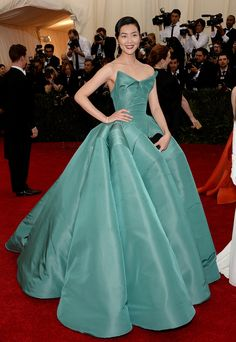 Liu Wen at the Met Gala. See more Charles James-worthy ball gowns at Vogue.com.