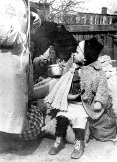 "Sept 1942. A child deported during the ""Sperre"" in the Lodz Ghetto, Poland. On Sept 5, 1942, the deportation known as the ""Sperre"" began - the roundup and removal of more than 15,000 children, elderly and ill Jews in one week from the Lodz Ghetto. Unlike elsewhere, news about the mass murder of the Jews had not reached the Lodz Ghetto. The brutal Aktion of September made it clear that deportation meant death."