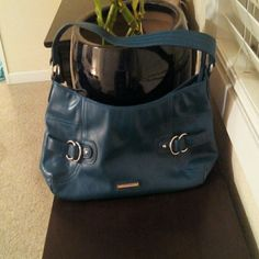 Blue Nine West  faux leather purse Lovely blue, like a dark peacock blue, faux leather nine west purse with silvertone details. Zipper closure. Clean interior with zipper pocket. Measures roughly 15x7in and 9in shoulder drop. In good condition. This beautiful purse is a reposh, sadly because I was looking for more of a greenish teal to match some shoes. Nine West Bags