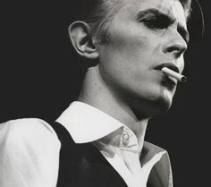 You are the Thin White Duke, and you are coke-aholic. You've passed the realm of experimentation and veered into the terrifying waters of hardcore, paranoid, skin-and-bones addiction.