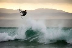 """Julian Wilson Surfing in Jeffreys Bay, South Africa. - Julian Wilson Surfing in Jeffreys Bay, South Africa. Ryan Miller / Red Bull Content Pool <a href=""""https://www.redbullphotography.com/editors-choice/1418308576509-825368698"""">Red Bull Photography</a>"""