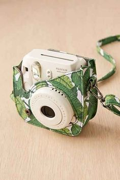 Fujifilm Instax Mini 8 Palm Camera Case from Urban Outfitters. Saved to Things I want as gifts. Polaroid Camera Case, Polaroid Instax Mini, Polaroid Foto, Cute Camera, Fujifilm Instax Mini 8, Film Polaroid, Anel Harry Potter, Dslr Photography Tips, Female Photography