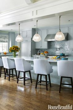A cool sea breeze washes over thisceruleanspace designed by Tobi Fairley, with matching counterstools to boot.