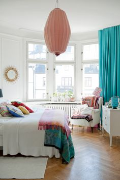 I love with this room. Turquoise drapes and salmon light fixture are amazing. @turquoise @colorful @bedroom