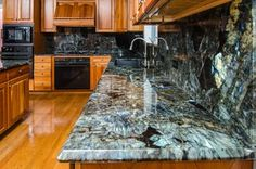 Countertops in my favorite mineral, YES. Blue Labradorite Kitchen with Full Backsplash. Blue Granite Countertops, Epoxy Countertop, Granite Slab, Granite Kitchen, Kitchen Countertops, Backsplash, Granite Colors, Kitchen Tops, New Kitchen