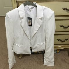 Brand new Guess blazer Never worn. NWT. 100% polyester. Beautiful blazer, I just decided I don't need it. Great for work or for a night out. Price is firm. Guess Jackets & Coats Blazers