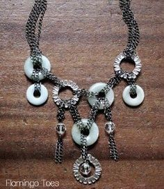 With stunning stone disk beads, rhinestone rings, and chains for days, this Chained Disk Necklace is one knockout knock-off project. Based on a designer Anthropologie accessory, this do-it-yourself necklace design is a more affordable option for fashion mavens of modest budget.