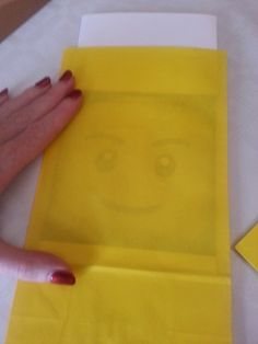 Trace a face for lego party bags