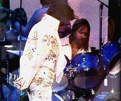 Drummer Ronnie Tutt:  ..But I was never really a big fan of his until 1969, and I met him. Once you meet him and you understand the charisma that the man had, you just can't help but love what he does. We immediately had a great rapport. Visually, our eyes were constantly watching each other.""