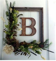 Picture frame with initial. I like this, but with simpler greenery.