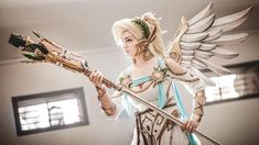 Winged Victory Mercy from Overwatch cosplay by Lara Wegenaer Arts photo by Andy K. photography #Mercycosplay #overwatch #cosplayclass #cosplaygirl