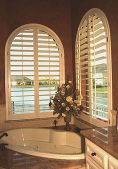 Arched Plantation Shutters By The Louver Shop Make A Great Backdrop For This Master Bedroom