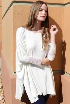 Chic style meets stylish/comfort with our ultra-sophisticated dolman top, finished with a flattering lace design for a flirty, feminine style statement and side-slits. #top #fashiontop #dolmantop #widetop #loosetop #longsleevetop #tunictop #tunic