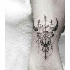 Cow skull tattoo.