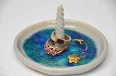 Ceramic ring and earings holder, baby blue glaze and melted blue glass on the bottom.