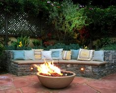 Warm up a chilly afternoon or add drama to an evening with a fire pit. | Pulte Homes