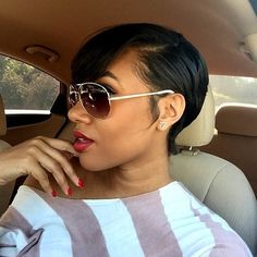Relaxed hair with a short cut and side part. Gel down edges for sleek look.